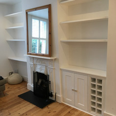 Alcove shelving, cupbiards and wine rack