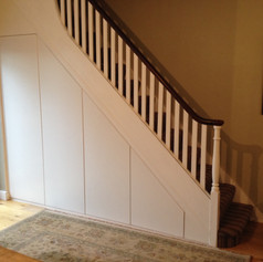 Flush-fronted understairs cupboards