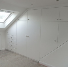 Loft alcove cupboard and shelving