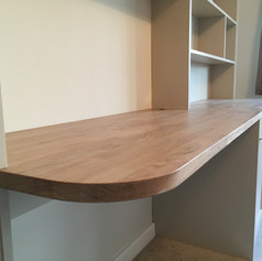 Oak desk with shelving and cupboards