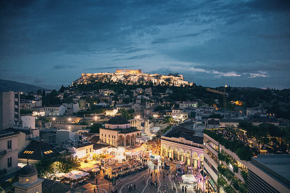 Cool sky-lit tones from twilight settle on the bustling streets of Athens, Greece