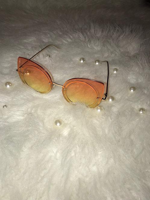 Kat eyes orange sunglasses