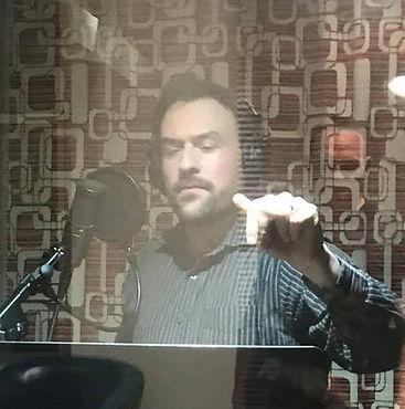 Voice Arts Award winner Noah DeBiase in the recording booth.
