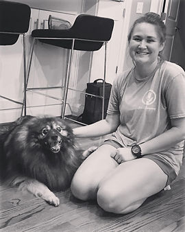 owner/operator of Lola & Co with a pet sitting dog client