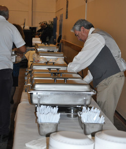 Volunteers set up the delicious meal