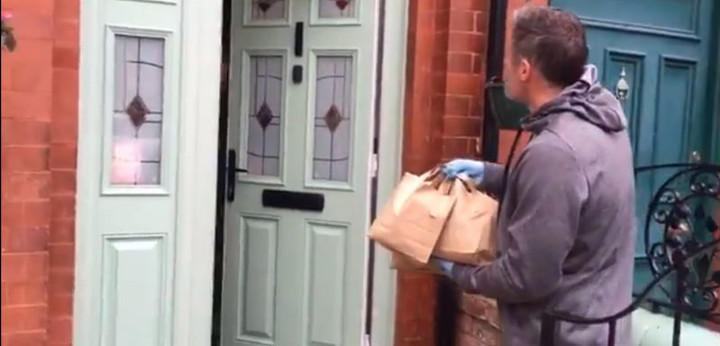 Jamie Carragher delivers food parcels to locals for MITC