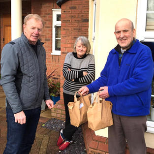 Liverpool FC legend David Fairclough helps hand out weekly lunch packages to our elderly and shielding