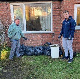 Volunteers help with gardening