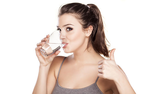 young beautiful woman drinks water from
