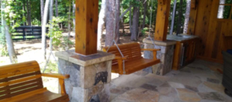 cedar porch swings hanging on patio