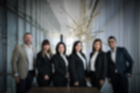Canva - Group of People In Dress Suits .