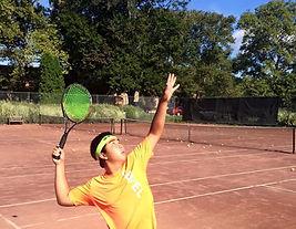 clay-court-serving.jpg