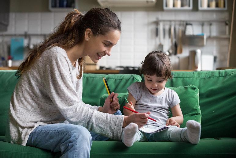 Smiling baby sitter and preschool kid gi