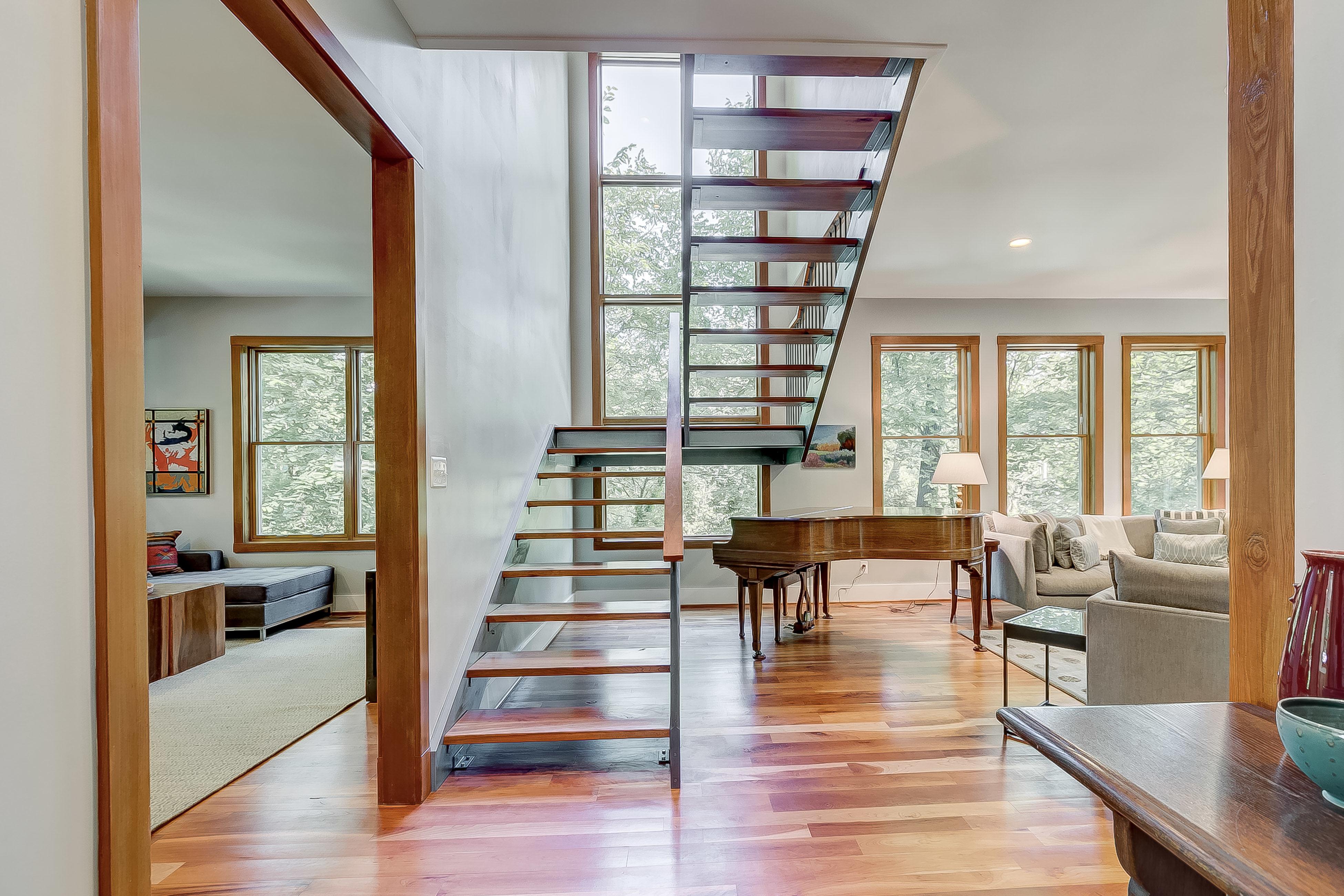 open the door + look straight through the main stair to sunlight + treetops