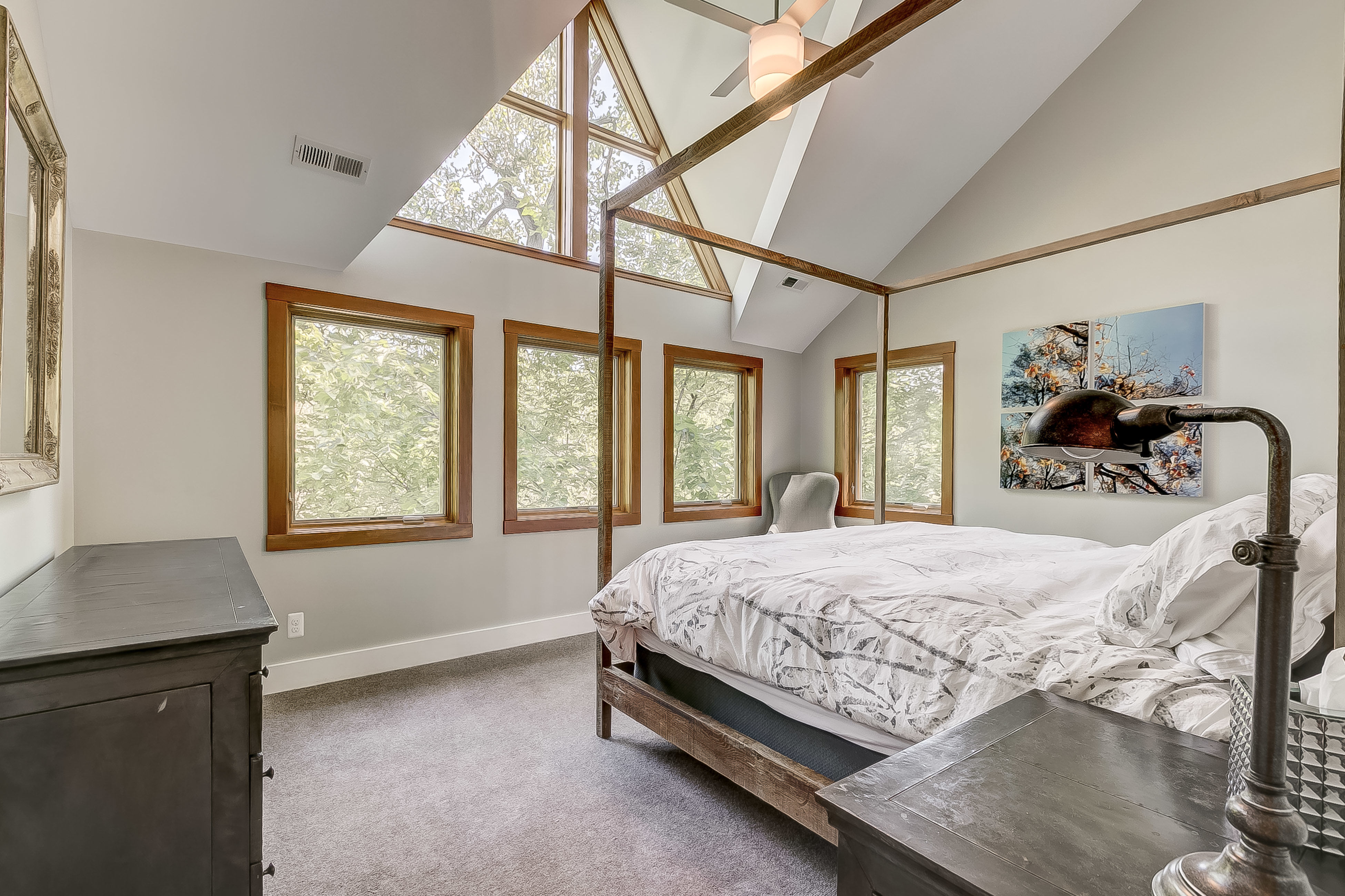 hang a left + be in awe of the lofted ceiling + wall of light in the main bedroom