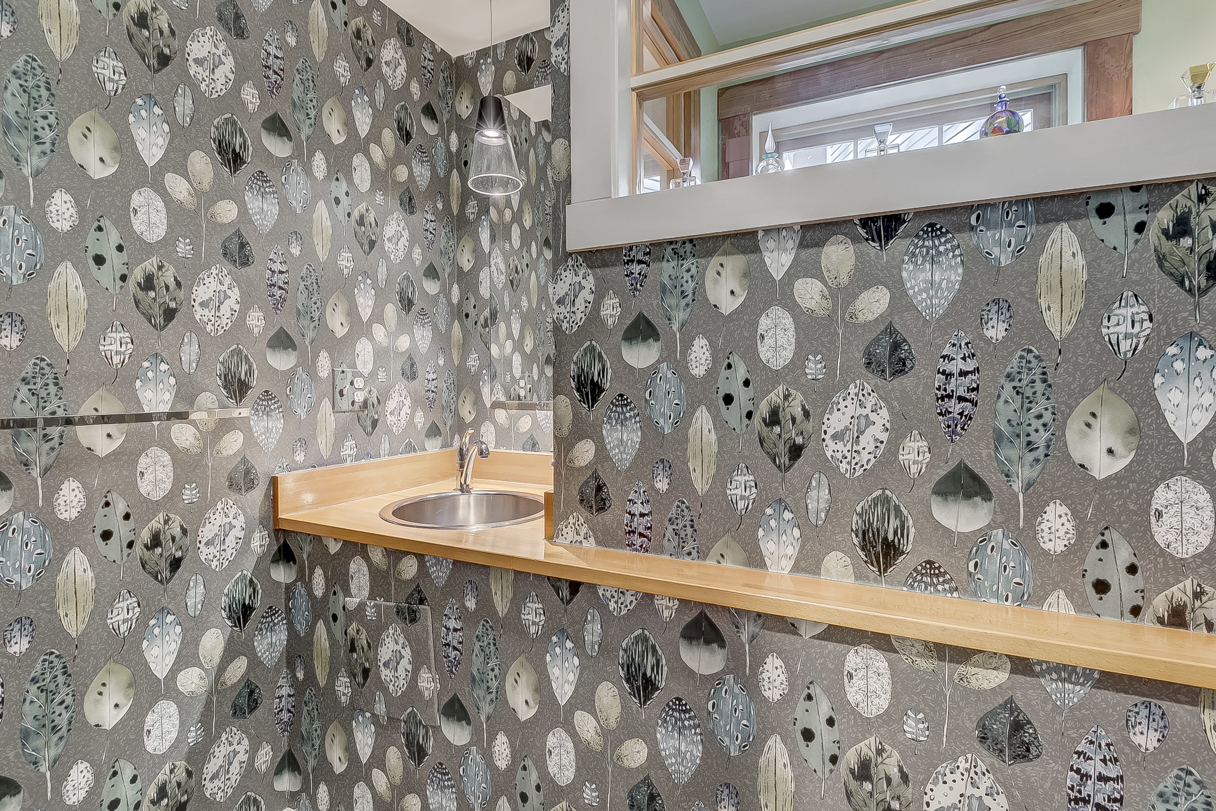 don't miss the powder room washed in light from the clerestory windows