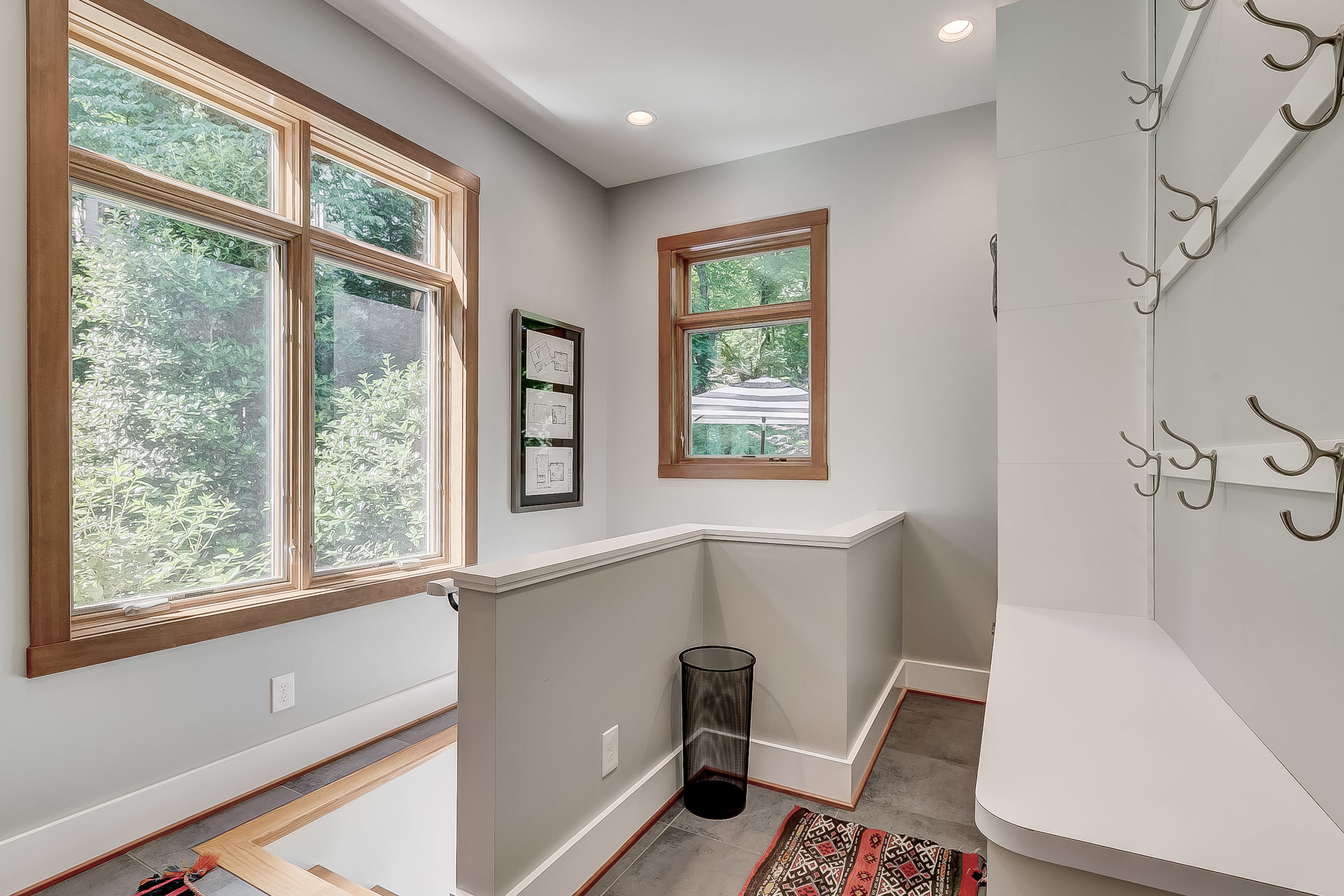 """remember that doorway next to the den? here is the perfect """"mud room"""" with shelves + hooks + closet"""