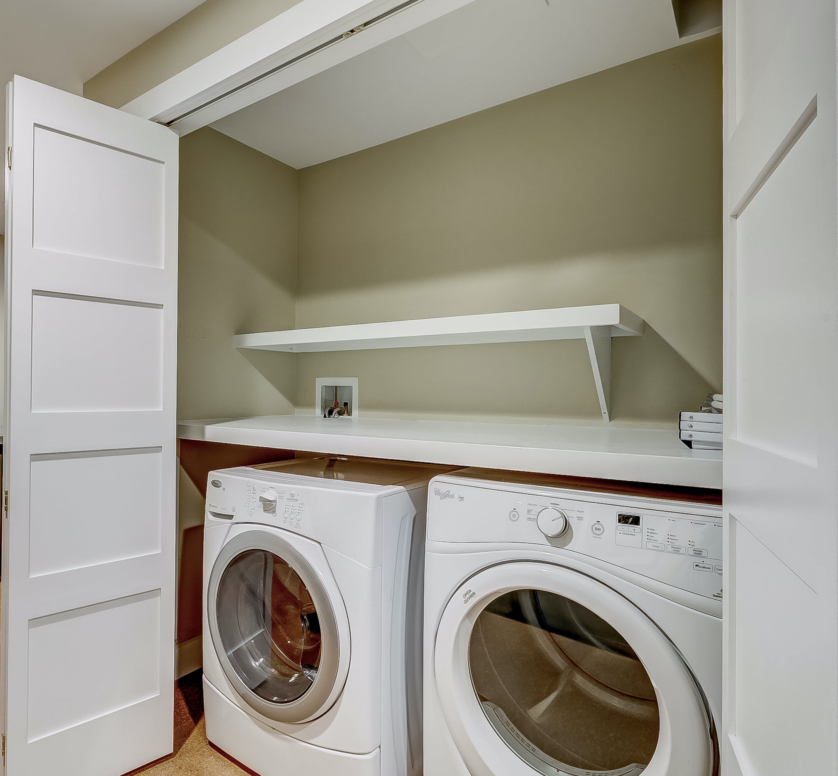 perfect laundry area + even a laundry chute from upper level bedrooms