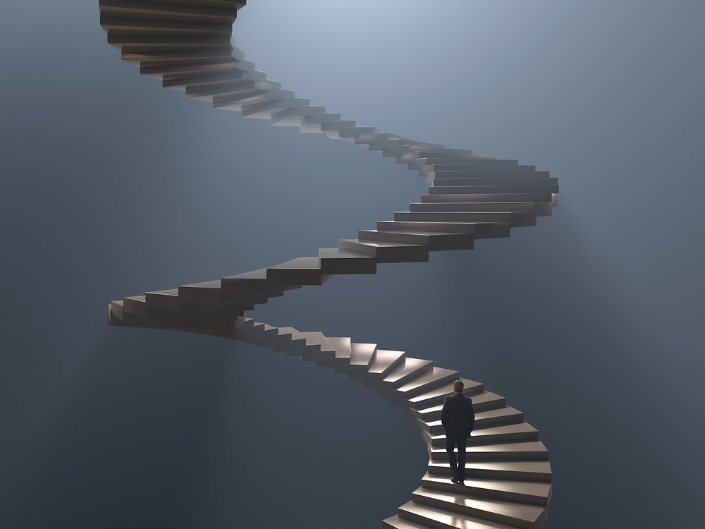 spiral staircase with man climbing it.