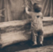 A young Montessori child exploring an image on a backdrop curtain