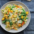 angel hair pasta with spring vegetables.