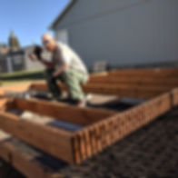 Our CEO building our frst better Urban Farm, th Farmlet
