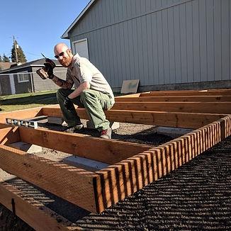 Our CEO building our frst better Urban Farm, th Farmlet