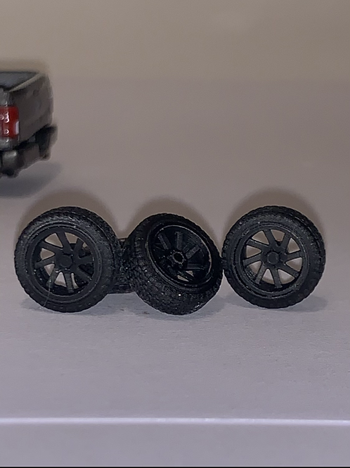 "1/64 22 in or 26""""Radiante""  wheels in black and tires"