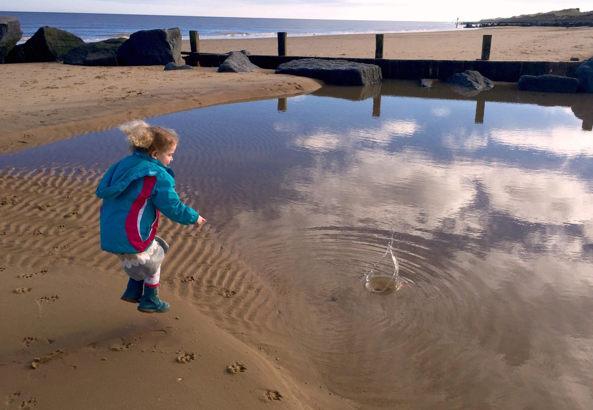 Girl plays on Norfolk beach