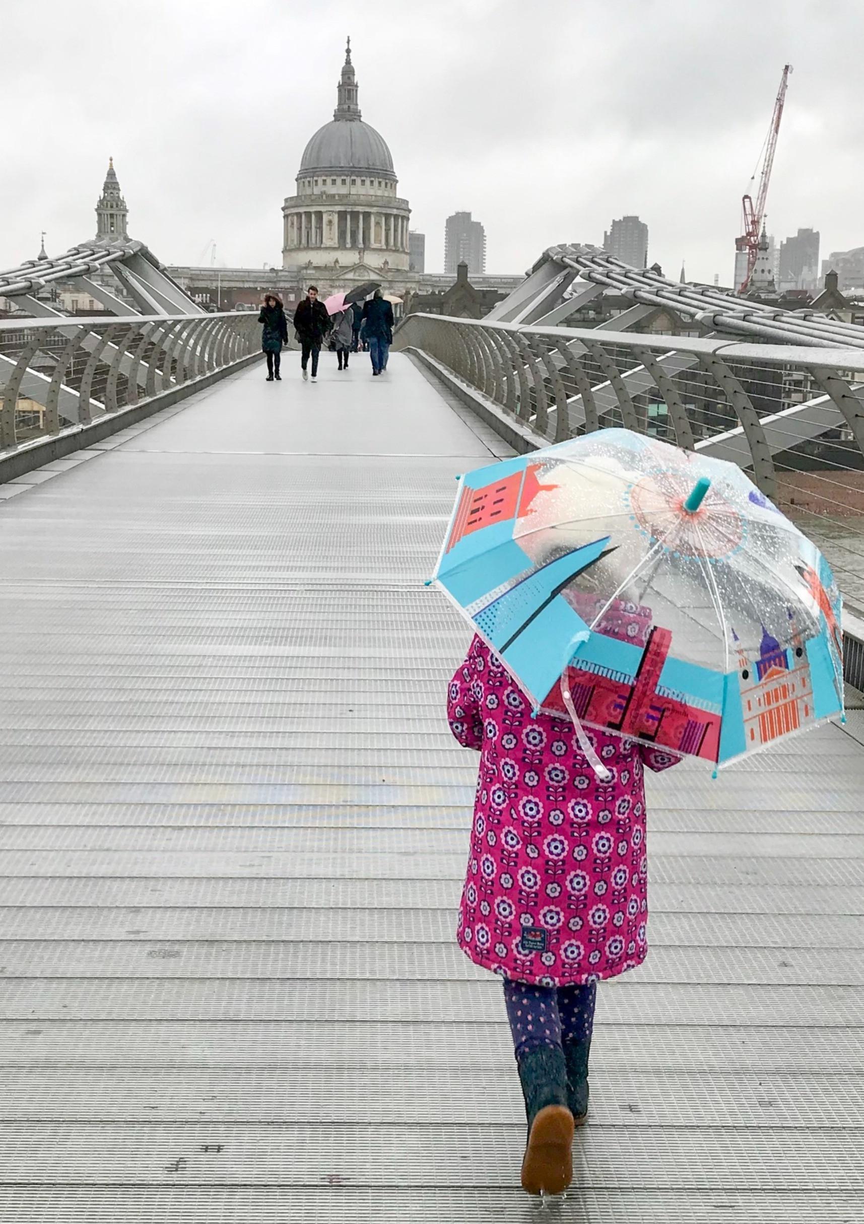 Girl with umbrella, Millennium Bridge, L