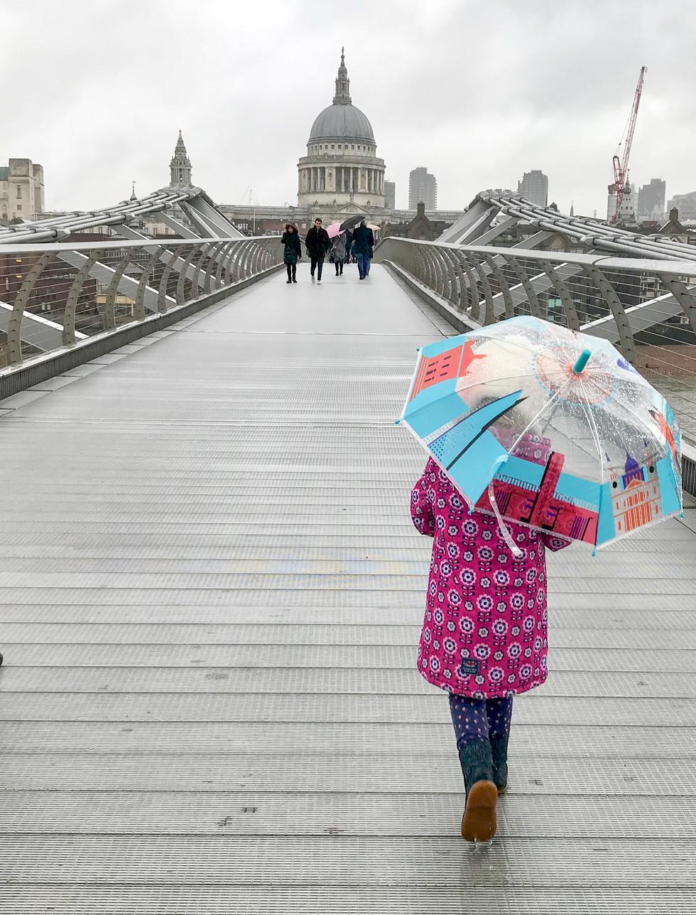 Millennium Bridge London and girl with umbrella