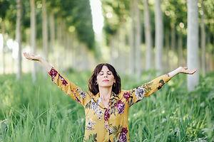 woman-arms-raised-enjoying-the-fresh-air