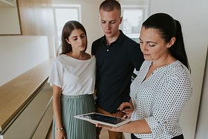 estate-agent-using-digital-tablet-showin