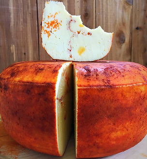 Raw Grass-fed gourmet cheese, made with smoked paprika.