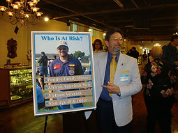Ronnie French, Vietnam Veteran & Vice President, poses with or awareness poster.