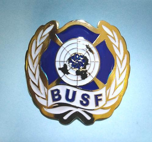 Escudo de armas BUSF em metal dourado