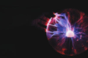 Hand on a crystal energy ball