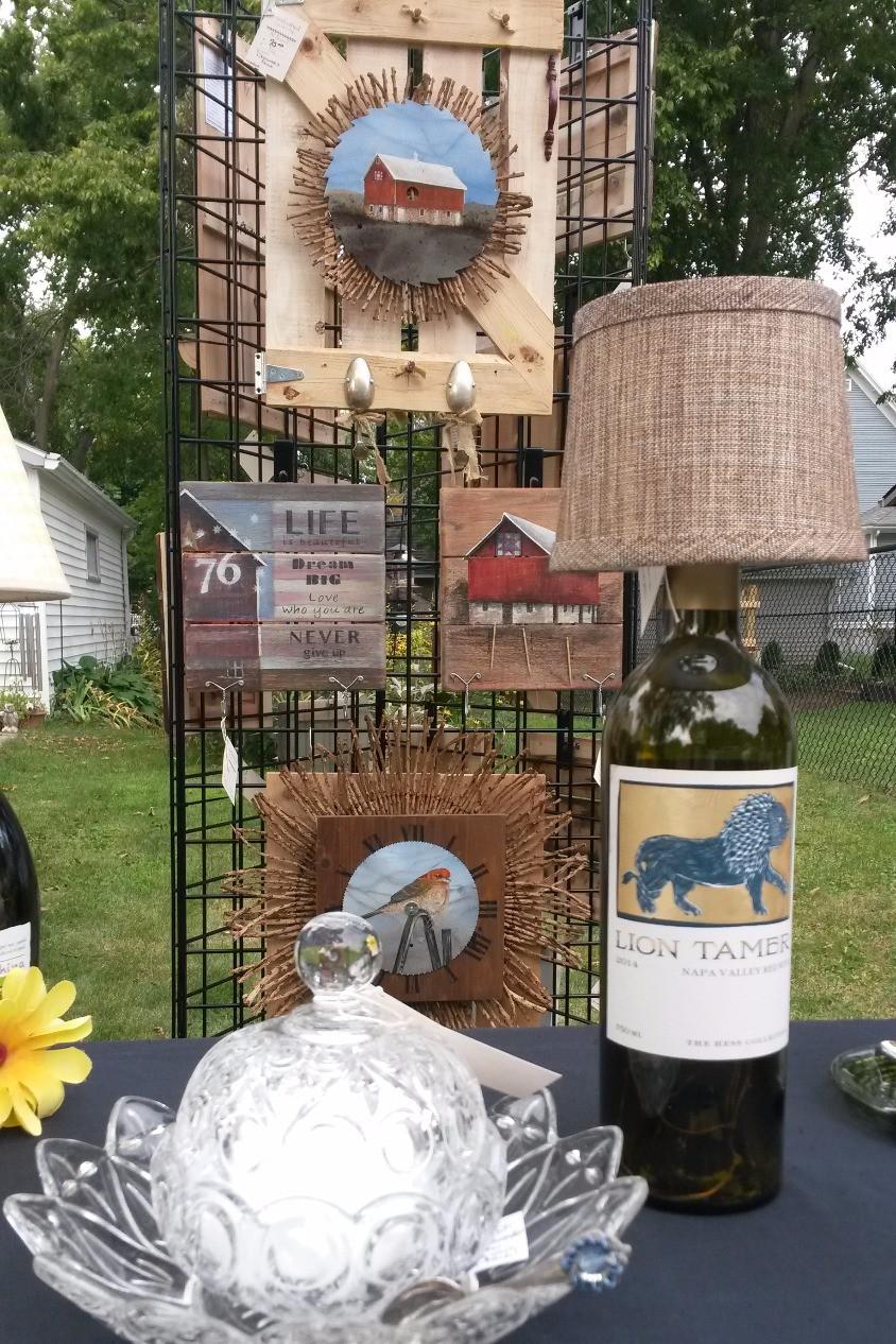 paintings on barn board, wine bottle lamp, glass bath salt dish
