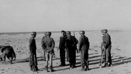 The Germans execute a patriot on the beach of Rethymno because he defended his village.