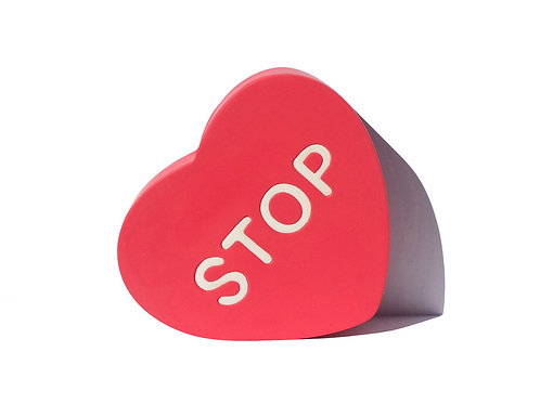 Red hand made silicone and resin Sculpture in heart shape by artist Brigitte Polemis titled Stop