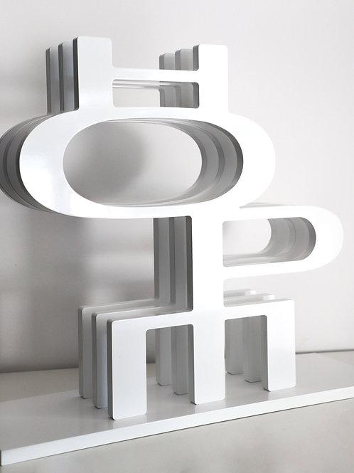 Wooden sculpture titled HOPE by visual artist Brigitte Polemis