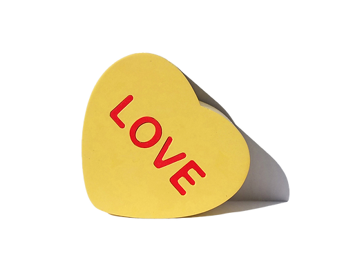 Yellow hand made silicone and resin Sculpture in heart shape by artist Brigitte Polemis titled Love