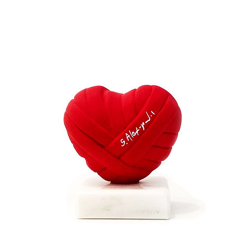 Red Coloured acrylic resin sculpture in Mini Size titled Love Me by sculptor Stathis Alexopoulos