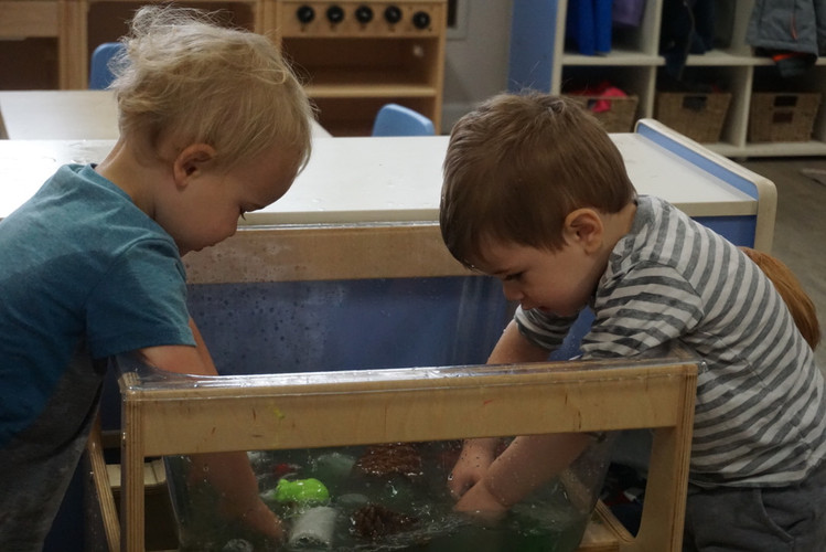 photo of Luca and Lincoln in sensory tab