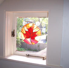Sugar Maple stained glass in the small window