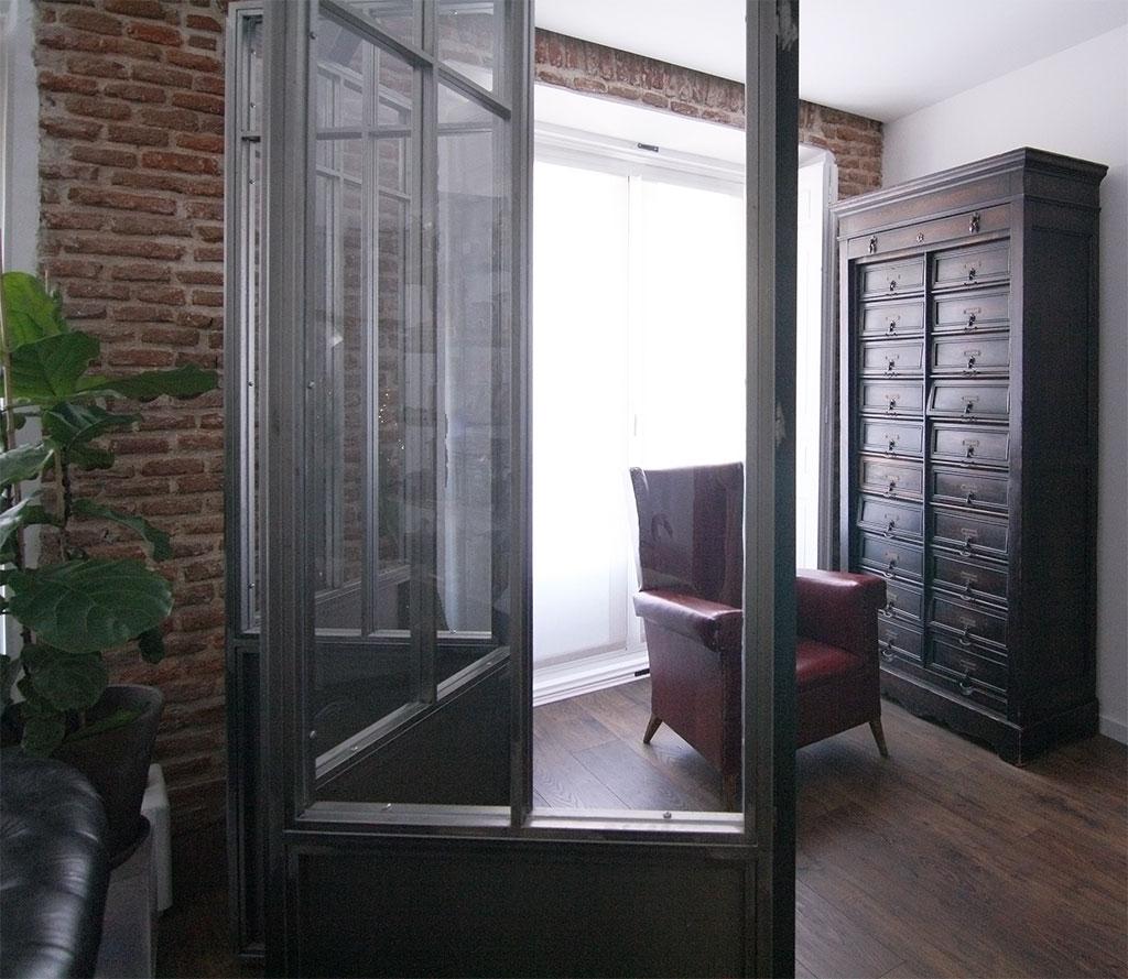 Panel móvil entre salón y despacho