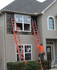 New Windows being installed by WB 4 Construction roofing contractors on ladders on a 2 story home