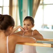Canva - Little ballerina in ballet studi