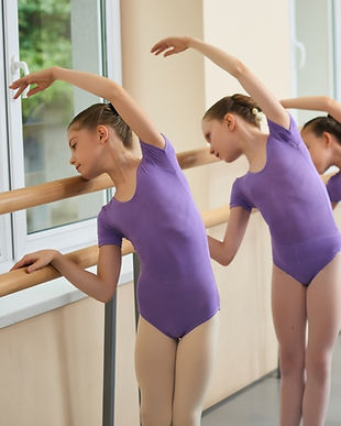 Canva - Group of ballerinas training at