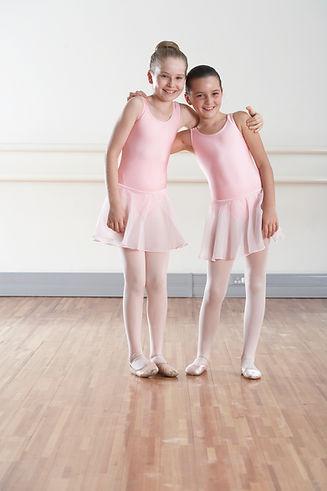 Canva - two ballet dancers smiling .jpg